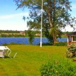 utsikt med egen strand vid stugan Linnea